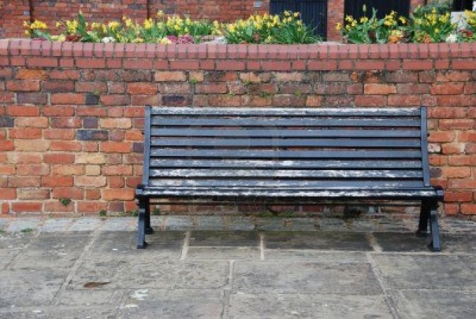 7195651-beautiful-sidewalk-scene-with-wooden-bench-brick-wall-and-flowers